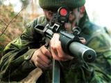 Soldier with Heckler & Koch submachine gun