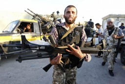 Libyan rebel holding H&K assault rifle in Gaddafi's compound